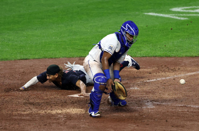 KANSAS CITY, MISSOURI - SEPTEMBER 01: Josh Naylor #31 of the Cleveland Indians slides safely into home to score as catcher Meibrys Viloria #72 of the Kansas City Royals misses the ball during the 7th inning of the game at Kauffman Stadium on September 01, 2020 in Kansas City, Missouri. (Photo by Jamie Squire/Getty Images)