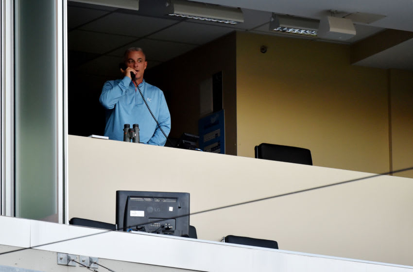 KANSAS CITY, MISSOURI - SEPTEMBER 03: General manager Dayton Moore of the Kansas City Royals talks on the phone prior to a game against the Chicago White Sox at Kauffman Stadium on September 03, 2020 in Kansas City, Missouri. (Photo by Ed Zurga/Getty Images)