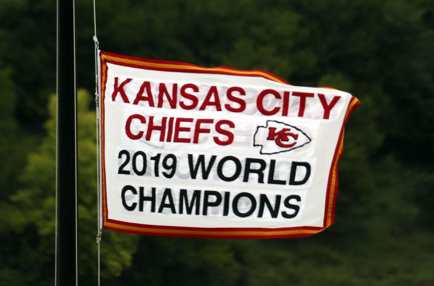 A flag commemorating the Chief's 2019 Superbowl Championship flies on a flagpole above the stadium (Photo by Jamie Squire/Getty Images)