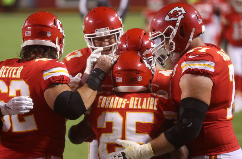 KANSAS CITY, MISSOURI - SEPTEMBER 10: Clyde Edwards-Helaire #25 of the Kansas City Chiefs is congratulated by teammates after scoring a touchdown against the Houston Texans during the third quarter at Arrowhead Stadium on September 10, 2020 in Kansas City, Missouri. (Photo by Jamie Squire/Getty Images)