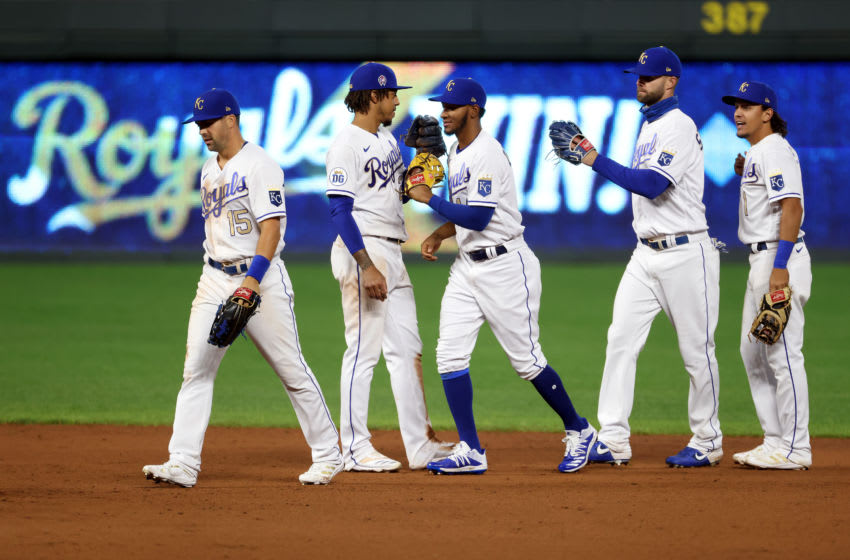 KANSAS CITY, MISSOURI - SEPTEMBER 11: Kansas City Royals players congratulate each other after the Royals defeated the Pittsburgh Pirates 4-3 to win the game at Kauffman Stadium on September 11, 2020 in Kansas City, Missouri. (Photo by Jamie Squire/Getty Images)