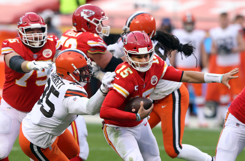 KANSAS CITY, MISSOURI - JANUARY 17: Quarterback Patrick Mahomes #15 of the Kansas City Chiefs scrambles as defensive end Myles Garrett #95 of the Cleveland Browns chases during the AFC Divisional Playoff game at Arrowhead Stadium on January 17, 2021 in Kansas City, Missouri. (Photo by Jamie Squire/Getty Images)