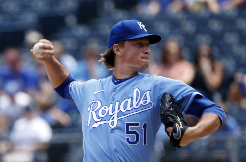 KANSAS CITY, MISSOURI - JULY 07: Starting pitcher Brady Singer #51 of the Kansas City Royals pitches during the 1st inning of the game against the Cincinnati Reds at Kauffman Stadium on July 07, 2021 in Kansas City, Missouri. (Photo by Jamie Squire/Getty Images)