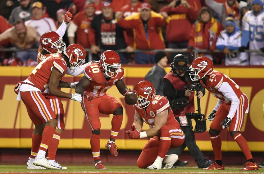 Kansas City Chiefs wide receiver Tyreek Hill (10) celebrates his 64-yard touchdown catch against the Los Angeles Chargers in the second quarter with a mock NASCAR pit crew stop on Saturday, Dec. 16, 2017, at Arrowhead Stadium in Kansas City, Mo. The Chiefs won, 30-13. (David Eulitt/Kansas City Star/TNS via Getty Images)