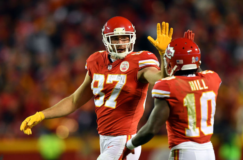 Tight end Travis Kelce #87 of the Kansas City Chiefs high-fives wide receiver Tyreek Hill #10 (Photo by Peter Aiken/Getty Images)