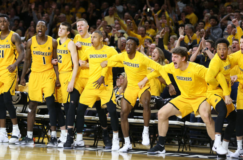 The Wichita State bench reacts to a dunk (Photo by Scott Winters/Icon Sportswire via Getty Images)