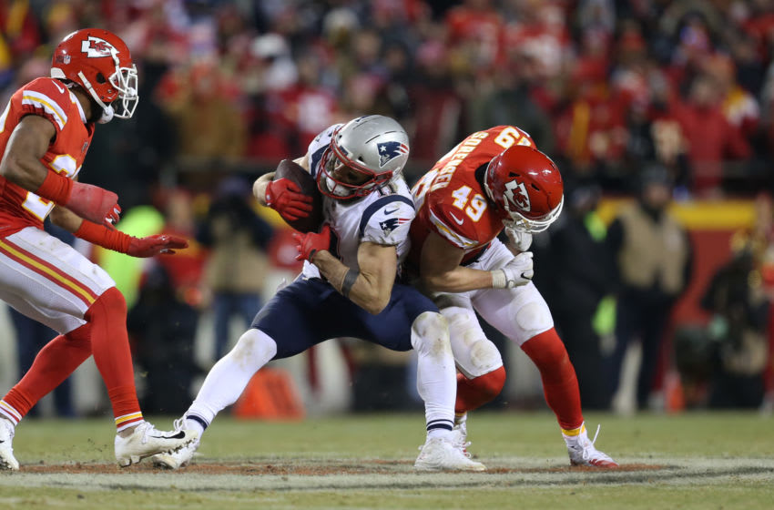 KANSAS CITY, MO - JANUARY 20: Kansas City Chiefs defensive back Daniel Sorensen (49) puts a hard hit on New England Patriots wide receiver Julian Edelman (11) after a 20-yard reception on 3rd and 10 with 13:40 left in overtime of the AFC Championship Game game between the New England Patriots and Kansas City Chiefs on January 20, 2019 at Arrowhead Stadium in Kansas City, MO. (Photo by Scott Winters/Icon Sportswire via Getty Images)