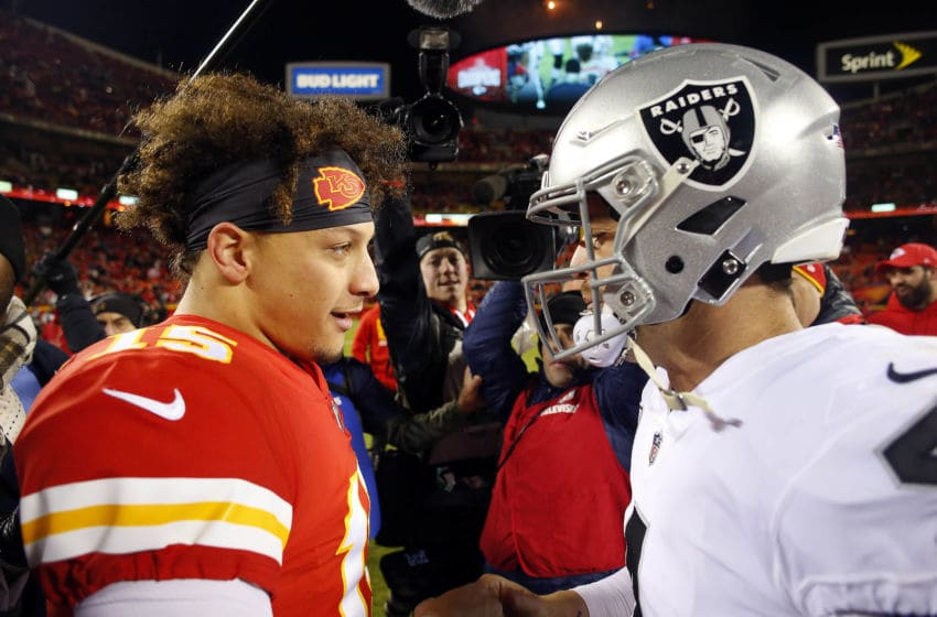 Quarterback Patrick Mahomes #15 of the Kansas City Chiefs greets quarterback Derek Carr #4 of the Oakland Raiders (Photo by Jamie Squire/Getty Images)