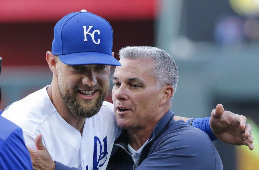 KANSAS CITY, MISSOURI - APRIL 27: Alex Gordon #4 of the Kansas City Royals and general manager Dayton Moore embrace before the game against the Los Angeles Angels of Anaheim at Kauffman Stadium on April 27, 2019 in Kansas City, Missouri. (Photo by John Sleezer/Getty Images)