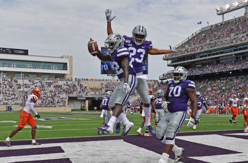 MANHATTAN, KS - SEPTEMBER 07: Running back Joe Ervin #22 of the Kansas State Wildcats celebrates after scoring a touchdown with wide receiver Joshua Youngblood #23 of the Kansas State Wildcats against the Bowling Green Falcons, during the second half at Bill Snyder Family Football Stadium on September 7, 2019 in Manhattan, Kansas. (Photo by Peter G. Aiken/Getty Images)