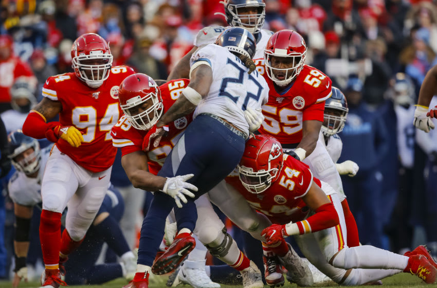 KANSAS CITY, MO - JANUARY 19: Chris Jones #95 of the Kansas City Chiefs and Damien Wilson #54 of the Kansas City Chiefs stop Derrick Henry #22 of the Tennessee Titans in the second quarter during the AFC Championship game at Arrowhead Stadium on January 19, 2020 in Kansas City, Missouri. (Photo by David Eulitt/Getty Images)