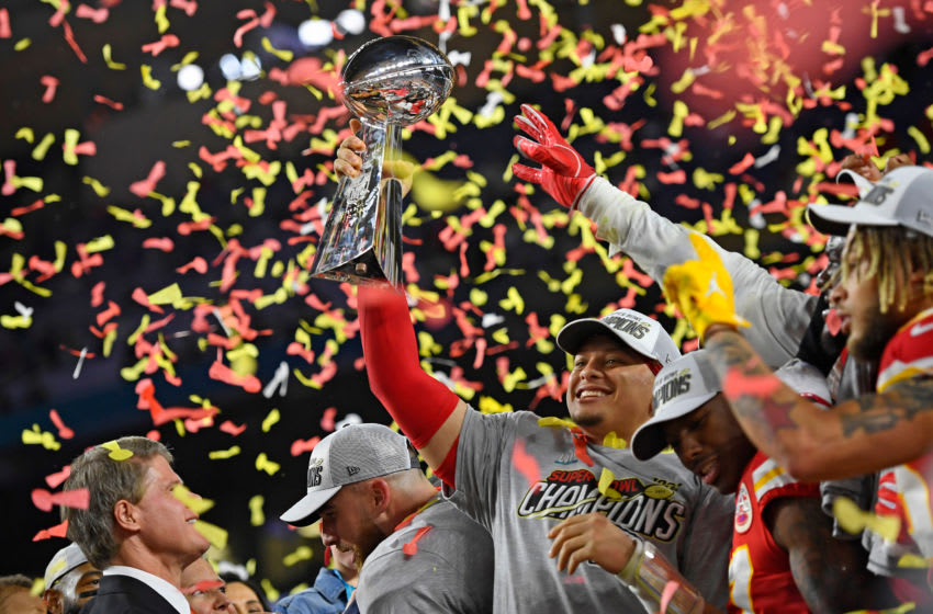 Kansas City Chiefs' quarterback Patrick Mahomes (15) holds up the Vince Lombardi Trophy after winning Super Bowl LIV (Jose Carlos Fajardo/MediaNews Group/The Mercury News via Getty Images)