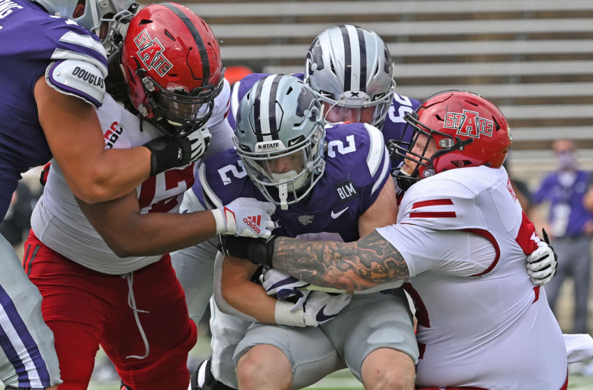 MANHATTAN, KS - SEPTEMBER 12: Running back Harry Trotter #2 of the Kansas State Wildcats gets raped up by Arkansas State Red Wolves defenders during the second half at Bill Snyder Family Football Stadium on September 12, 2020 in Manhattan, Kansas. (Photo by Peter Aiken/Getty Images)