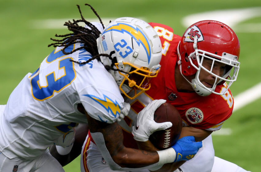 INGLEWOOD, CALIFORNIA - SEPTEMBER 20: Travis Kelce #87 of the Kansas City Chiefs reacts to a hit from Rayshawn Jenkins #23 of the Los Angeles Chargers during 23-20 Chiefs win at SoFi Stadium on September 20, 2020 in Inglewood, California. (Photo by Harry How/Getty Images)