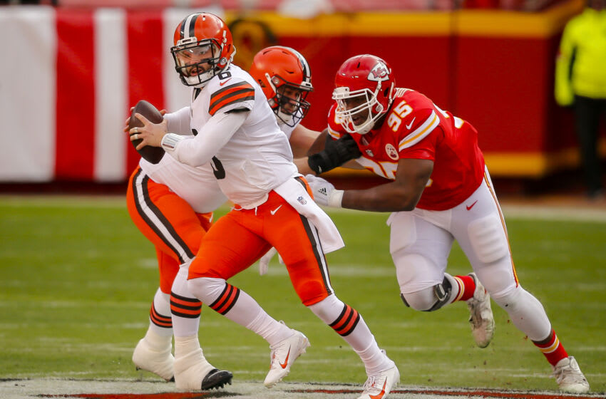 KANSAS CITY, MO - JANUARY 17: Chris Jones #95 of the Kansas City Chiefs pressures Baker Mayfield #6 of the Cleveland Browns in the first quarter during the game against the Cleveland Browns in the AFC Divisional Playoff at Arrowhead Stadium on January 17, 2021 in Kansas City, Missouri. (Photo by David Eulitt/Getty Images)