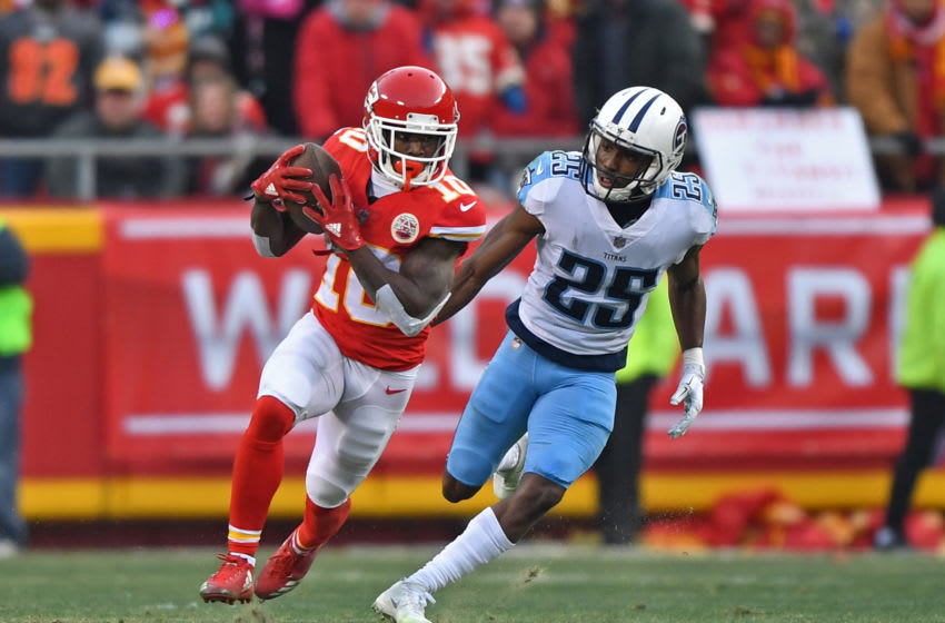 KANSAS CITY, MO - JANUARY 6: Wide receiver Tyreek Hill #10 of the Kansas City Chiefs turns up field after catching a pass against cornerback Adoree' Jackson #25 of the Tennessee Titans during the first half of the game at Arrowhead Stadium on January 6, 2018 in Kansas City, Missouri. (Photo by Peter G. Aiken/Getty Images)