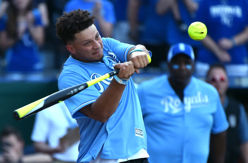 KANSAS CITY, MISSOURI - JUNE 07: Quarterback Patrick Mahomes (back) of the Kansas City Chiefs hits a ball during the Big Slick celebrity softball game prior to a game between the Chicago White Sox and Kansas City Royals at Kauffman Stadium on June 07, 2019 in Kansas City, Missouri. (Photo by Ed Zurga/Getty Images)