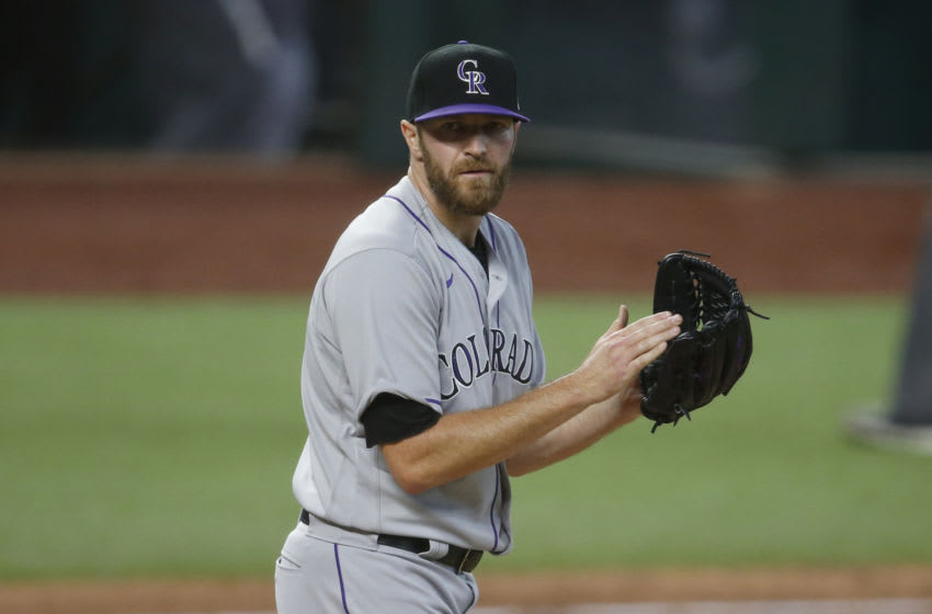 Jul 26, 2020; Arlington, Texas, USA; Colorado Rockies relief pitcher Wade Davis (71) reacts after the final out in the game against the Texas Rangers at Globe Life Field. Mandatory Credit: Tim Heitman-USA TODAY Sports