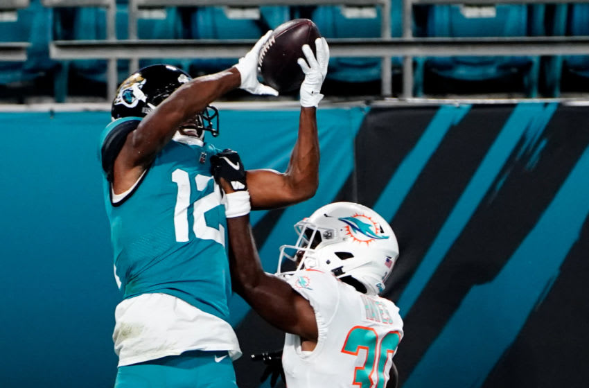 Sep 24, 2020; Jacksonville, Florida, USA; Miami Dolphins cornerback Tae Hayes (30) is called for pass interference in the end zone on a pass intended for Jacksonville Jaguars wide receiver wide receiver Dede Westbrook (12) during the second half at TIAA Bank Field. Mandatory Credit: Douglas DeFelice-USA TODAY Sports