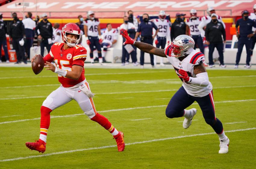 Oct 5, 2020; Kansas City, Missouri, USA; Kansas City Chiefs quarterback Patrick Mahomes (15) runs away from New England Patriots pressure during the first quarter of a NFL game at Arrowhead Stadium. Mandatory Credit: Jay Biggerstaff-USA TODAY Sports