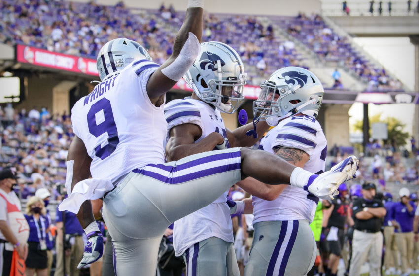Oct 10, 2020; Fort Worth, Texas, USA; Kansas State Wildcats wide receiver Chabastin Taylor (13) and fullback Jax Dineen (29) and running back Jacardia Wright (9) celebrate a two point conversion against the TCU Horned Frogs during the first half at Amon G. Carter Stadium. Mandatory Credit: Jerome Miron-USA TODAY Sports