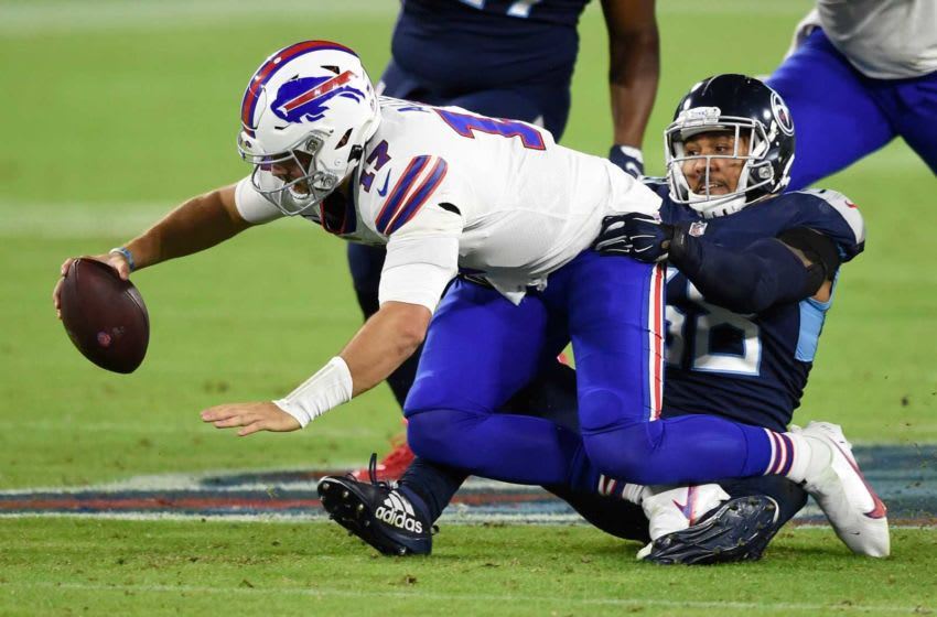 Tennessee Titans outside linebacker Harold Landry (58) sacks Buffalo Bills quarterback Josh Allen (17) during the second quarter at Nissan Stadium Tuesday, Oct. 13, 2020 in Nashville, Tenn. Gw44596