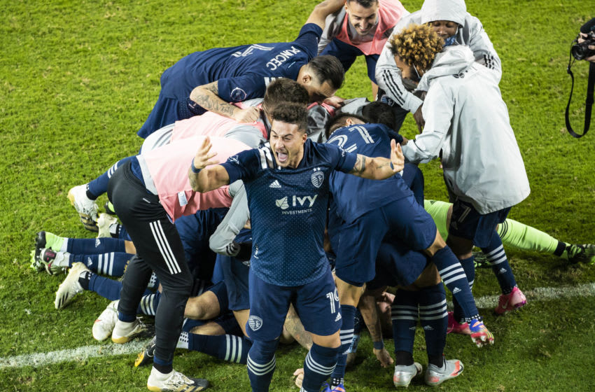 Nov 22, 2020; Kansas City, Kansas, USA; Sporting Kansas City forward Erik Hurtado (19) celebrates with teammates after defeating the San Jose Earthquakes in penalty kicks at Children's Mercy Park. Mandatory Credit: Jay Biggerstaff-USA TODAY Sports