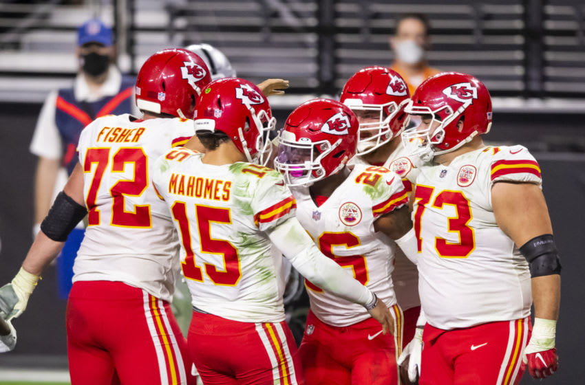 Nov 22, 2020; Paradise, Nevada, USA; Kansas City Chiefs quarterback Patrick Mahomes (15) celebrates a touchdown with running back Le'Veon Bell (26) against the Las Vegas Raiders in the fourth quarter at Allegiant Stadium. Mandatory Credit: Mark J. Rebilas-USA TODAY Sports