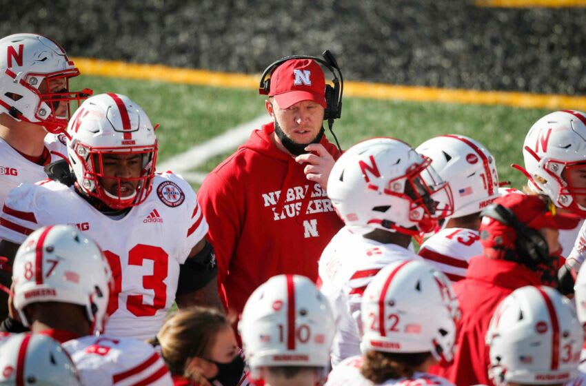 Nebraska head football coach Scott Frost huddles his team during a timeout against Iowa at Kinnick Stadium in Iowa City on Friday, Nov. 27, 2020. 20201127 Iowavsneb