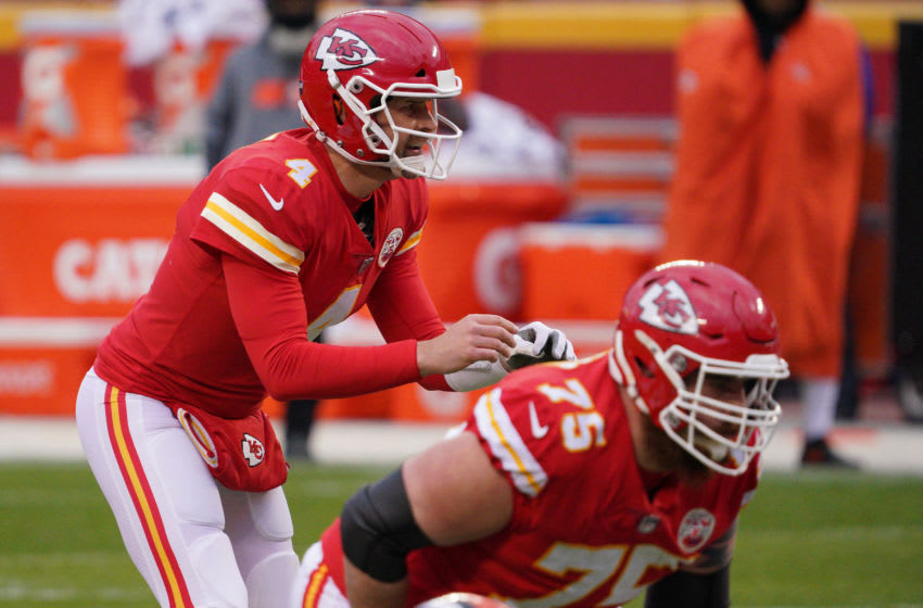 Jan 17, 2021; Kansas City, Missouri, USA; Kansas City Chiefs quarterback Chad Henne (4) takes the snap against the Cleveland Browns during the second half in the AFC Divisional Round playoff game at Arrowhead Stadium. Mandatory Credit: Denny Medley-USA TODAY Sports