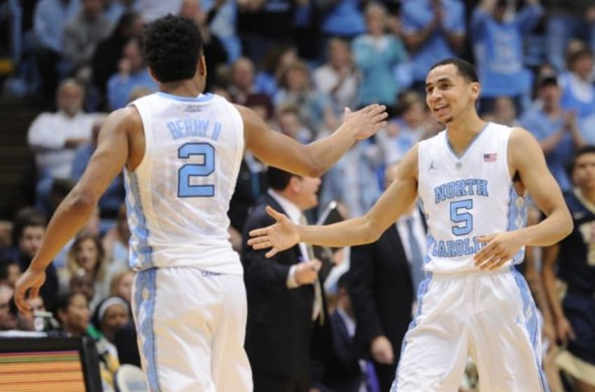 Feb 14, 2016; Chapel Hill, NC, USA; North Carolina Tar Heels guard Marcus Paige (5) and guard Joel Berry II (2) celebrate during the second half in game against the Pittsburgh Panthers at Dean E. Smith Center. The Tar Heels won 85-64. Mandatory Credit: Evan Pike-USA TODAY Sports