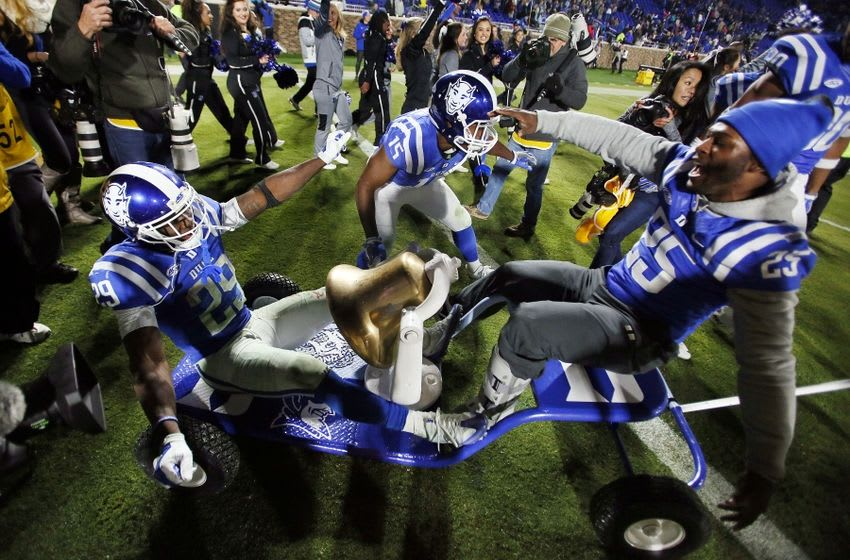 Nov 10, 2016; Durham, NC, USA; Duke Blue Devils running back Shaun Wilson (29) and running back Quay Mann (15) and running back Jela Duncan (25) celebrate with the victory bell after beating the North Carolina Tar Heels 28-27 at Wallace Wade Stadium. Mandatory Credit: Mark Dolejs-USA TODAY Sports