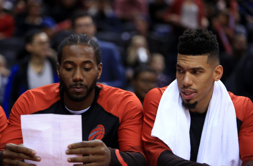 TORONTO, ON - OCTOBER 5: Kawhi Leonard #2 and Danny Green #14 of the Toronto Raptors sit on the bench reading the half time stats during the second half of an NBA preseason game against Melbourne United at Scotiabank Arena on October 5, 2018 in Toronto, Canada. NOTE TO USER: User expressly acknowledges and agrees that, by downloading and or using this photograph, User is consenting to the terms and conditions of the Getty Images License Agreement. (Photo by Vaughn Ridley/Getty Images)