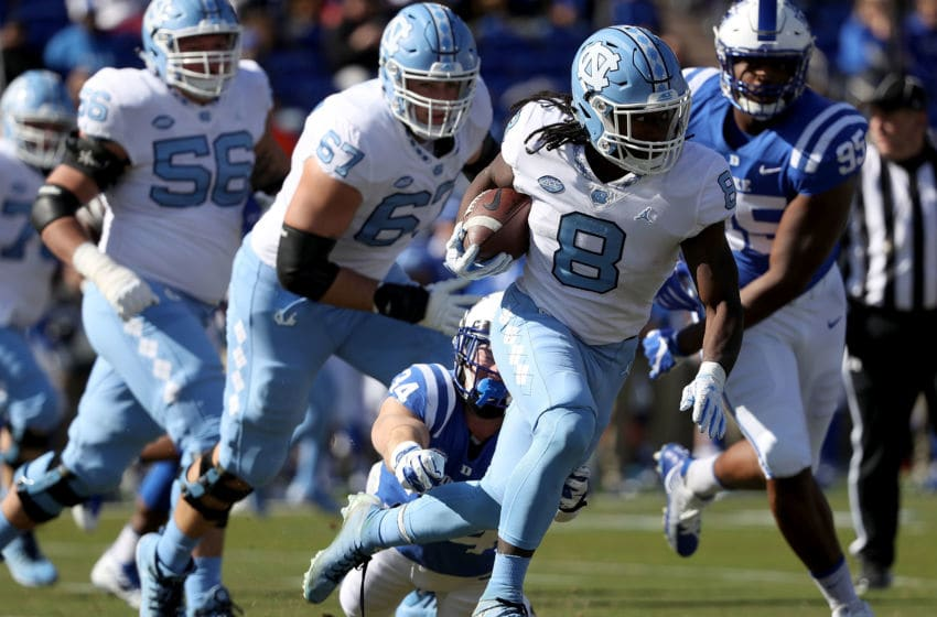 DURHAM, NC - NOVEMBER 10: Ben Humphreys #34 of the Duke Blue Devils tries to stop Michael Carter #8 of the North Carolina Tar Heels during their game at Wallace Wade Stadium on November 10, 2018 in Durham, North Carolina. (Photo by Streeter Lecka/Getty Images)