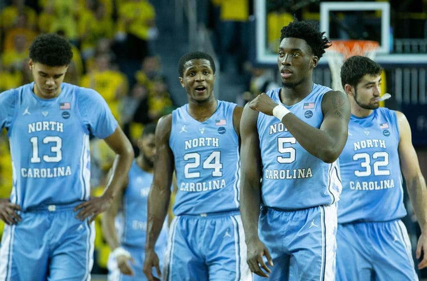 ANN ARBOR, MI - NOVEMBER 28: Nassir Little #5 of the North Carolina Tar Heels and teammates Cameron Johnson #13, Kenny Williams #24 and Luke Maye #32 of the North Carolina Tar Heels walk to the sidelines during a timeout in the second half of the game against the Michigan Wolverines at Crisler Center on November 28, 2018 in Ann Arbor, Michigan. Michigan defeated North Carolina Tar Heels 84-67. (Photo by Leon Halip/Getty Images)