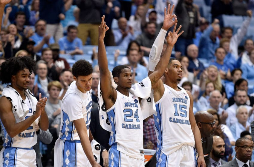 CHAPEL HILL, NORTH CAROLINA - NOVEMBER 19: (L-R) Leaky Black #1, Cameron Johnson #13, Kenny Williams #24 and Garrison Brooks #15 of the North Carolina Tar Heels react during the second half of their game against the St. Francis Red Flash at the Dean Smith Center on November 19, 2018 in Chapel Hill, North Carolina. North Carolina won 101-76. (Photo by Grant Halverson/Getty Images)