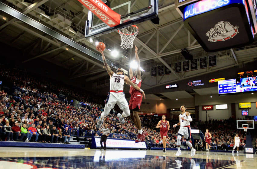 SPOKANE, WA - JANUARY 05: Josh Perkins #13 of the Gonzaga Bulldogs goes to the basket against Trey Wertz #1 of the Santa Clara Broncos in the first half at McCarthey Athletic Center on January 5, 2019 in Spokane, Washington. (Photo by William Mancebo/Getty Images)