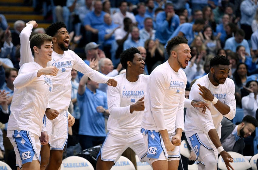 CHAPEL HILL, NORTH CAROLINA - FEBRUARY 23: The North Carolina Tar Heels bench reacts after a three-point basket against the Florida State Seminoles during the first half of their game at the Dean Smith Center on February 23, 2019 in Chapel Hill, North Carolina. (Photo by Grant Halverson/Getty Images)