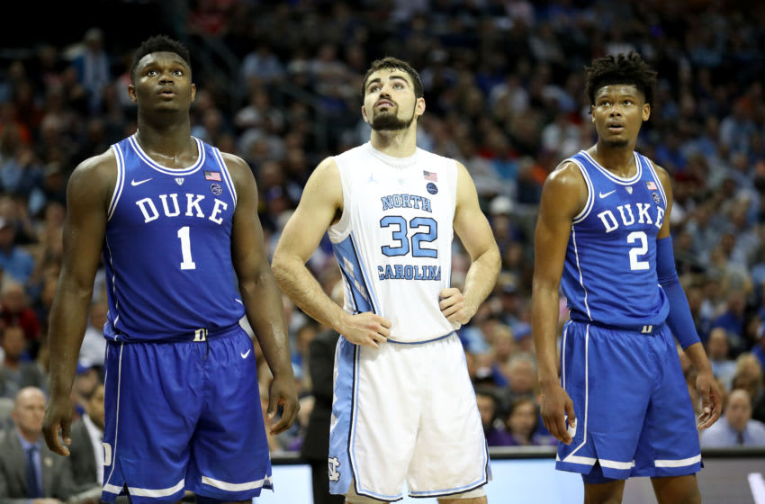 CHARLOTTE, NORTH CAROLINA - MARCH 15: Teammates Zion Williamson #1 and Cam Reddish #2 of the Duke Blue Devils await a free throw with Luke Maye #32 of the North Carolina Tar Heels during their game in the semifinals of the 2019 Men's ACC Basketball Tournament at Spectrum Center on March 15, 2019 in Charlotte, North Carolina. (Photo by Streeter Lecka/Getty Images)