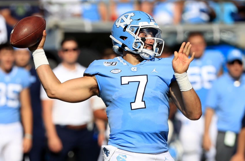 CHARLOTTE, NORTH CAROLINA - AUGUST 31: Sam Howell #7 of the North Carolina Tar Heels drops back to pass against the South Carolina Gamecocks during the Belk College Kickoff game at Bank of America Stadium on August 31, 2019 in Charlotte, North Carolina. (Photo by Streeter Lecka/Getty Images)