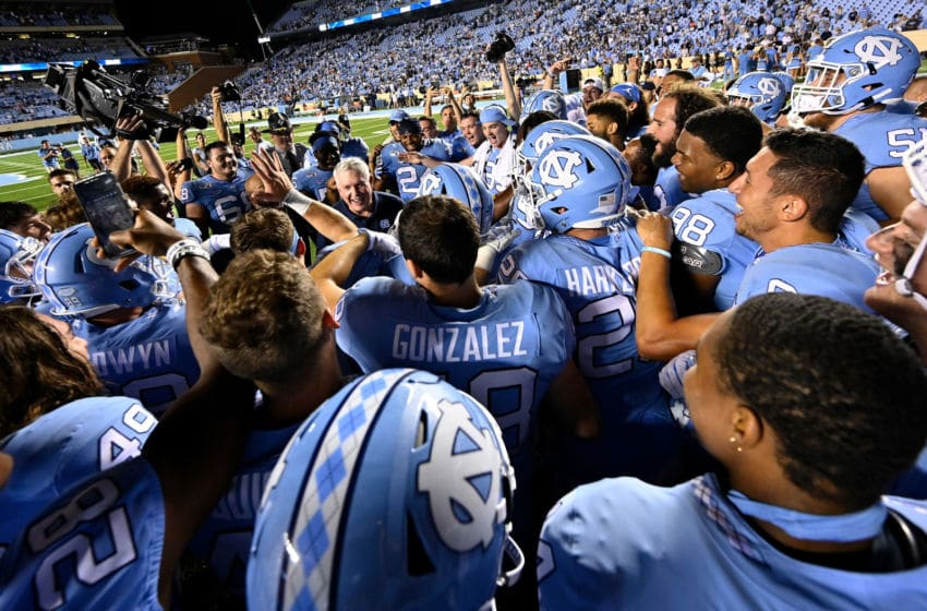 CHAPEL HILL, NORTH CAROLINA - SEPTEMBER 07: Head coach Mack Brown of the North Carolina Tar Heels celebrates with players after a win against the Miami Hurricanes at Kenan Stadium on September 07, 2019 in Chapel Hill, North Carolina. North Carolina won 28-25. (Photo by Grant Halverson/Getty Images)