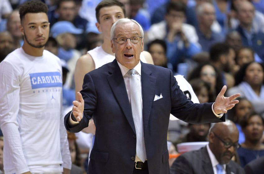 CHAPEL HILL, NORTH CAROLINA - NOVEMBER 06: Head coach Roy Williams of the North Carolina Tar Heels directs his team against the Notre Dame Fighting Irish during the first half at the Dean Smith Center on November 06, 2019 in Chapel Hill, North Carolina. (Photo by Grant Halverson/Getty Images)