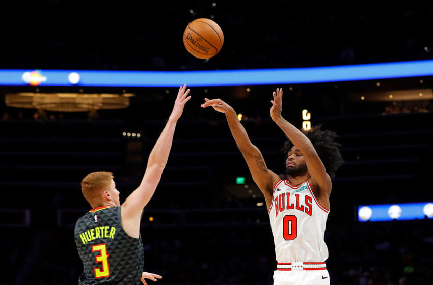 ATLANTA, GEORGIA - NOVEMBER 06: Coby White #0 of the Chicago Bulls shoots a three-point basket against Kevin Huerter #3 of the Atlanta Hawks in the second half at State Farm Arena on November 06, 2019 in Atlanta, Georgia. NOTE TO USER: User expressly acknowledges and agrees that, by downloading and/or using this photograph, user is consenting to the terms and conditions of the Getty Images License Agreement. (Photo by Kevin C. Cox/Getty Images)