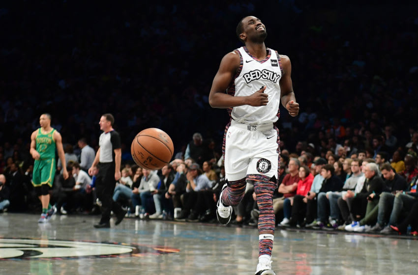 NEW YORK, NEW YORK - NOVEMBER 29: Theo Pinson #1 of the Brooklyn Nets reacts to a call during the second half of their game against the Boston Celtics at Barclays Center on November 29, 2019 in New York City. NOTE TO USER: User expressly acknowledges and agrees that, by downloading and or using this Photograph, user is consenting to the terms and conditions of the Getty Images License Agreement. (Photo by Emilee Chinn/Getty Images)