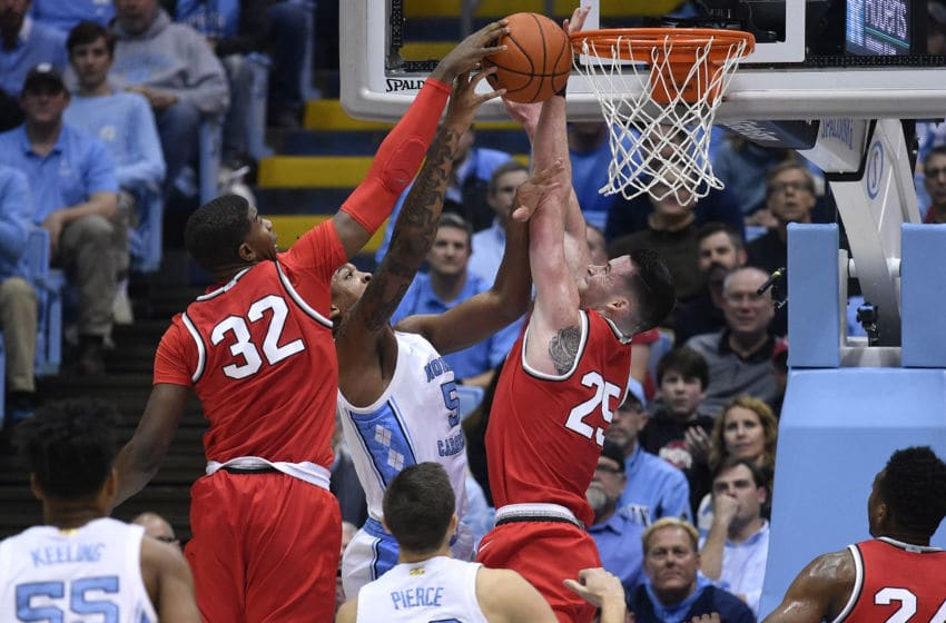 CHAPEL HILL, NORTH CAROLINA - DECEMBER 04: E.J. Liddell #32 and Kyle Young #25 of the Ohio State Buckeyes block a shot by Armando Bacot #5 of the North Carolina Tar Heels during the first half of their game at the Dean Smith Center on December 04, 2019 in Chapel Hill, North Carolina. (Photo by Grant Halverson/Getty Images)
