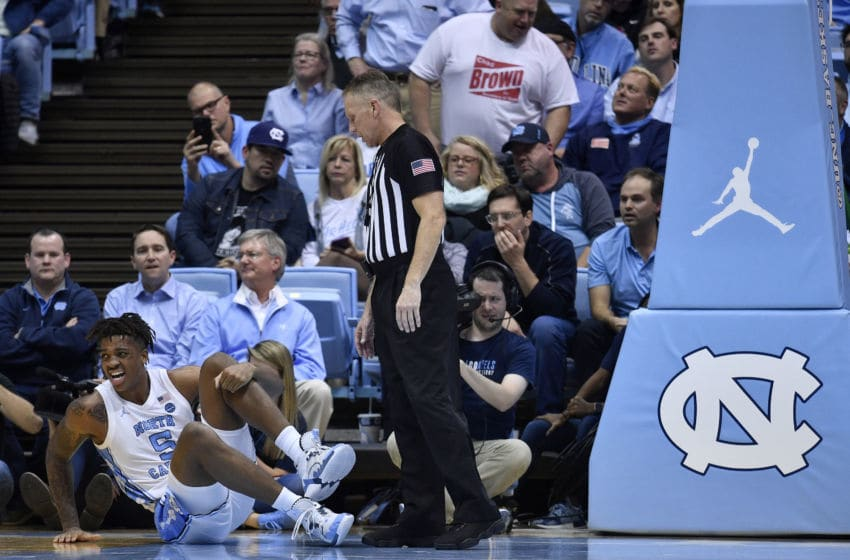 CHAPEL HILL, NORTH CAROLINA - DECEMBER 04: Armando Bacot #5 of the North Carolina Tar Heels reacts after being injured during the first half of their game against the Ohio State Buckeyesat the Dean Smith Center on December 04, 2019 in Chapel Hill, North Carolina. (Photo by Grant Halverson/Getty Images)