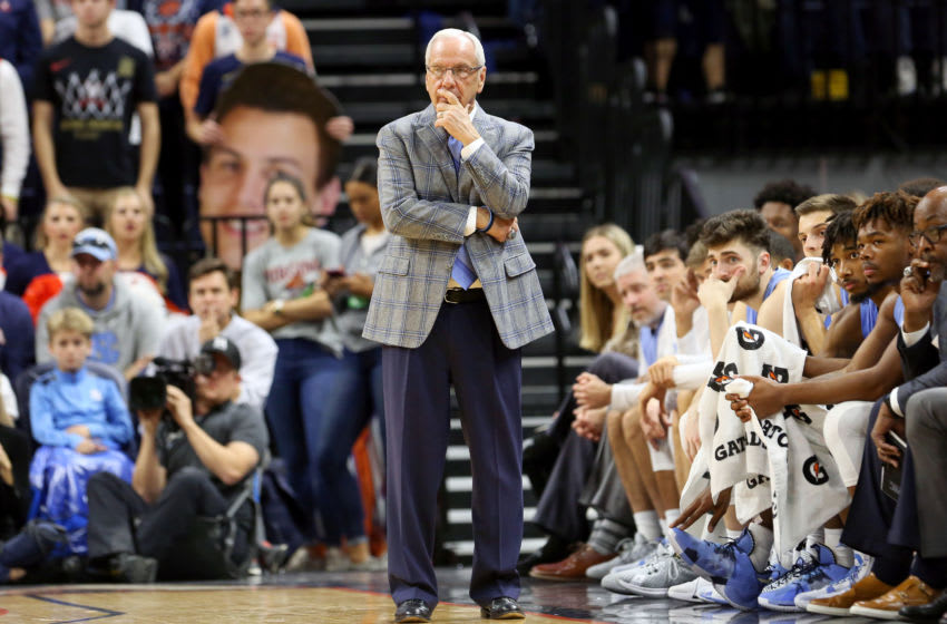 CHARLOTTESVILLE, VA - DECEMBER 07: Head coach Roy Williams of the North Carolina Tar Heels watches a play in the second half during a game against the Virginia Cavaliers at John Paul Jones Arena on December 7, 2019 in Charlottesville, Virginia. (Photo by Ryan M. Kelly/Getty Images)
