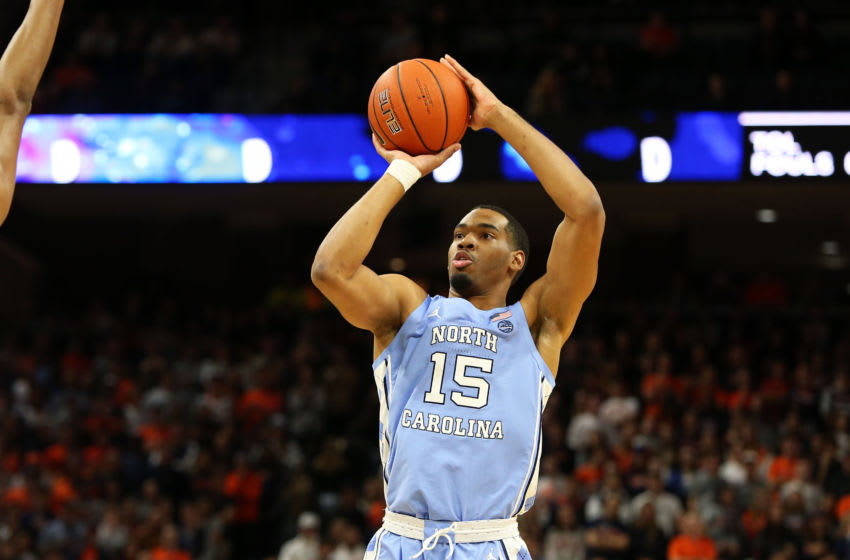 CHARLOTTESVILLE, VA - DECEMBER 07: Garrison Brooks #15 of the North Carolina Tar Heels shoots in the first half during a game against the Virginia Cavaliers at John Paul Jones Arena on December 7, 2019 in Charlottesville, Virginia. (Photo by Ryan M. Kelly/Getty Images)