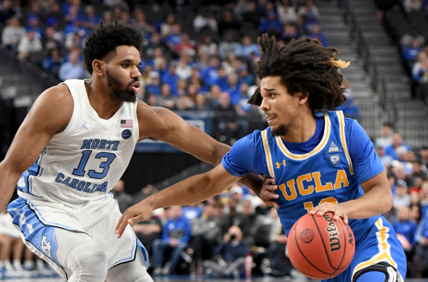LAS VEGAS, NEVADA - DECEMBER 21: Tyger Campbell #10 of the UCLA Bruins drives against Jeremiah Francis #13 of the North Carolina Tar Heels during the CBS Sports Classic at T-Mobile Arena on December 21, 2019 in Las Vegas, Nevada. The Tar Heels defeated the Bruins 74-64. (Photo by Ethan Miller/Getty Images)