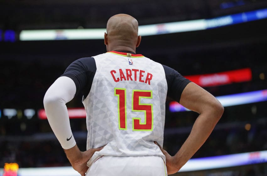 CHICAGO, ILLINOIS - DECEMBER 28: Vince Carter #15 of the Atlanta Hawks waits for play to begin against the Chicago Bulls at the United Center on December 28, 2019 in Chicago, Illinois. The Bulls defeated the Hawks 116-81. NOTE TO USER: User expressly acknowledges and agrees that, by downloading and or using this photograph, User is consenting to the terms and conditions of the Getty Images License Agreement. (Photo by Jonathan Daniel/Getty Images)